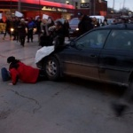 Video: Car runs over protesters during Ferguson rally. #Mikebrown