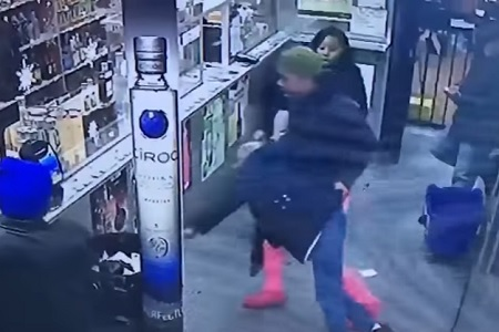 girl-pushes-throws-an-old-lady-in-garbage-can-in-liquor-store