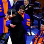 University Of Florida College Students Pushed Offstage During Ceremony.