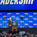 Man arrested after throwing his cell phone at president Trump during his speech